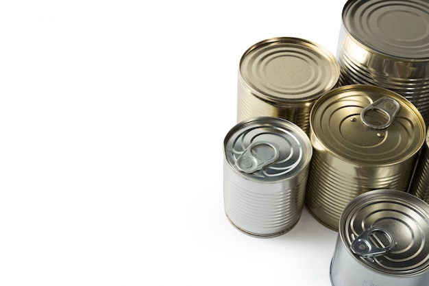 Metal cans on a white.