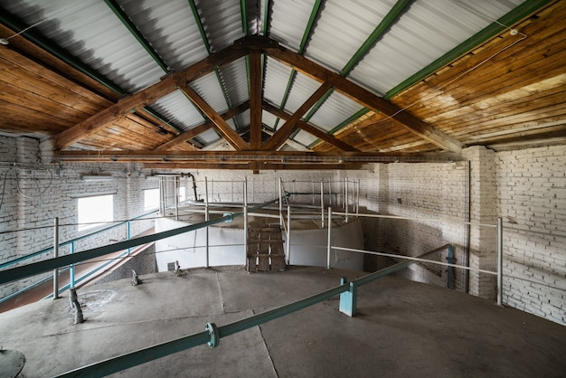 Metal cisterns installed inside the building. the liquid store.