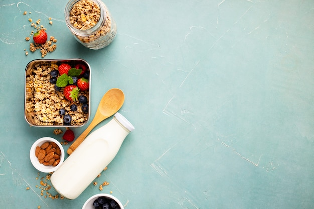 Metal container with ingredients for healthy breakfast