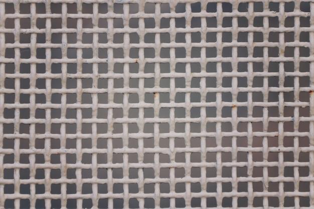 Metal dense mesh, white color.