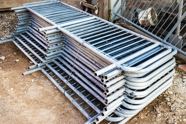 Metal fences are folded at the construction site, prepared for installation. pirila for installation in a residential building.
