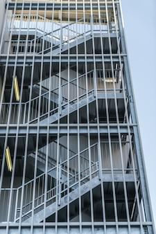 Metal fire escape outside building .