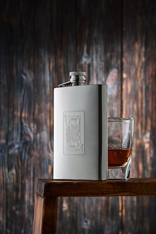 A metal flask for alcohol