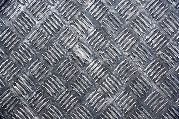 Metal floor plate with diamond pattern, iron texture.
