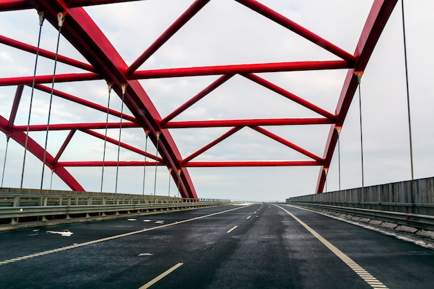 Metal frame structure of a bridge over a highway road
