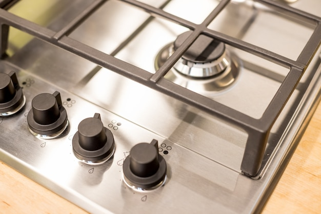 Metal gas stove on modern kitchen