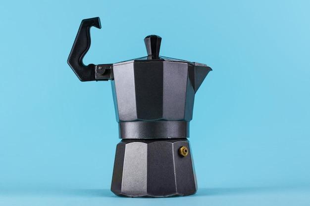 A metal, geyser coffee maker