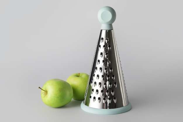 Metal grater and apples on grey background