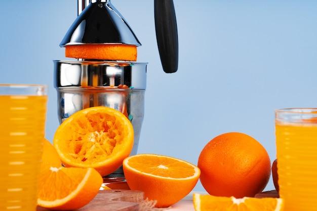 Metal hand orange juice squeezer close up