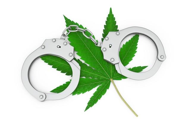 흰색 배경에 의료용 마리화나 또는 대마초 잎이 있는 금속 수갑. 3d 렌더링