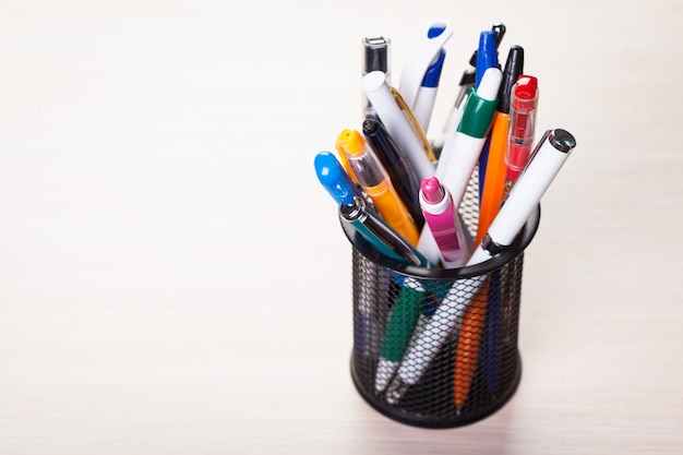Metal holder with pens