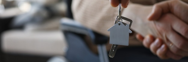 Metal house symbol on keychain