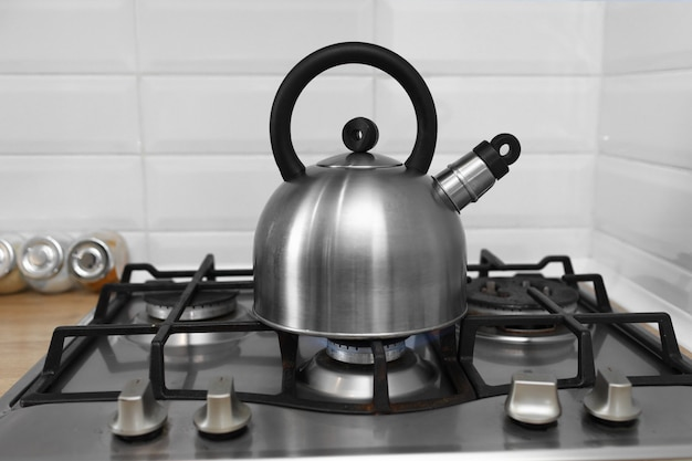 Metal kettle on a gas stove
