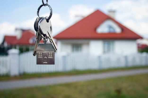 Metal keys to a new house on residential buildings.
