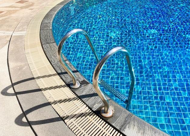 Metal ladder at swimming pool