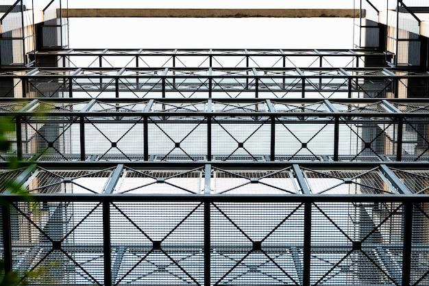 Metal mesh on steel walkways between buildings to communicate.