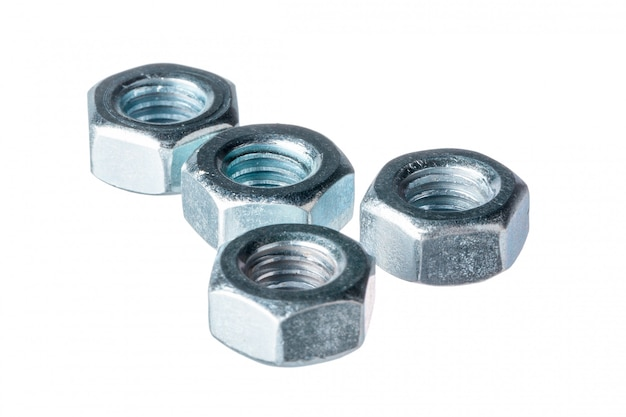 Metal nuts on white background