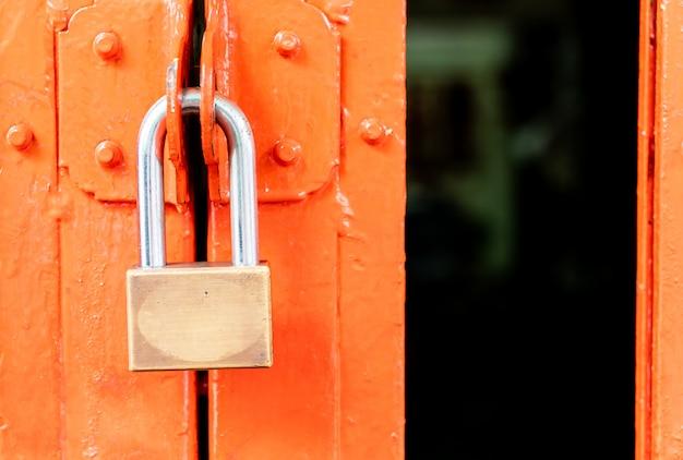 Metal padlock on door