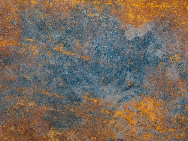 Metal plate with weathered colors and rust.