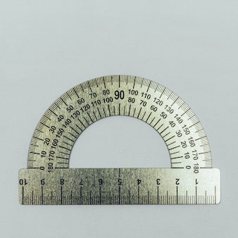 Metal protractor close-up on grey background