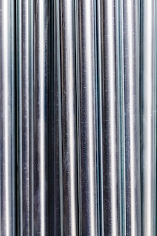 Metal rods steel pipes line background