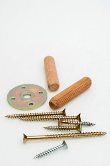 Metal screws and wooden plugs