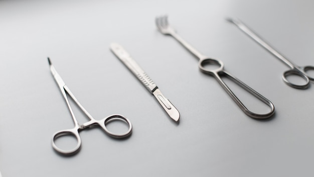 Metal set of medical instruments on a white background