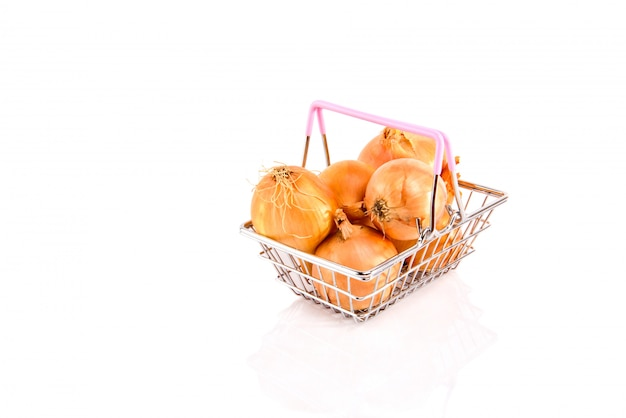 Metal shopping basket with onion isolated on white.