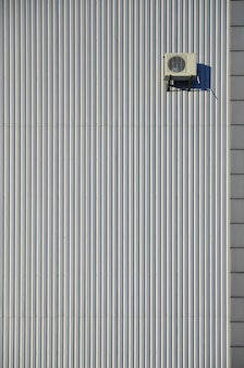 Metal siding wall with air conditioning