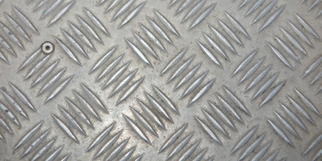 Metal silver industrial wall diamond steel pattern background texture for designer