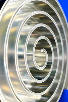 Metal spiral polished metal shallow depth of field.