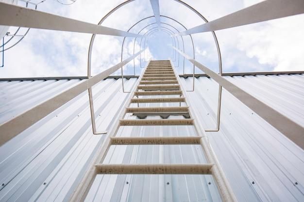 Metal stairway working platform, up to to crude oil storage vessel tanker