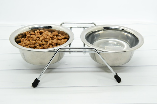 Metal stand for two bowls for dog food and water. Premium Photo