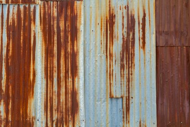 스크래치와 균열, 녹 벽이 있는 금속 질감