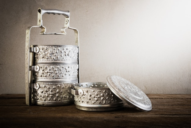 Metal tiffin carrier, thai food carrier on wooden table background