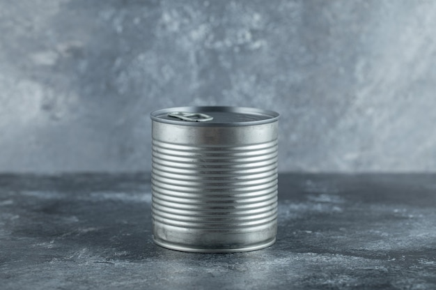 Metal tin can placed on marble.