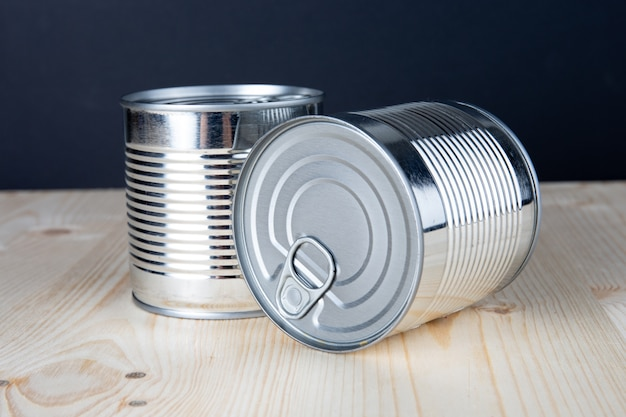 Metal tin can on wooden table