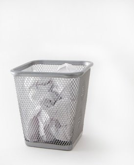 Metal trash can, bin with crumpled paper, isolated