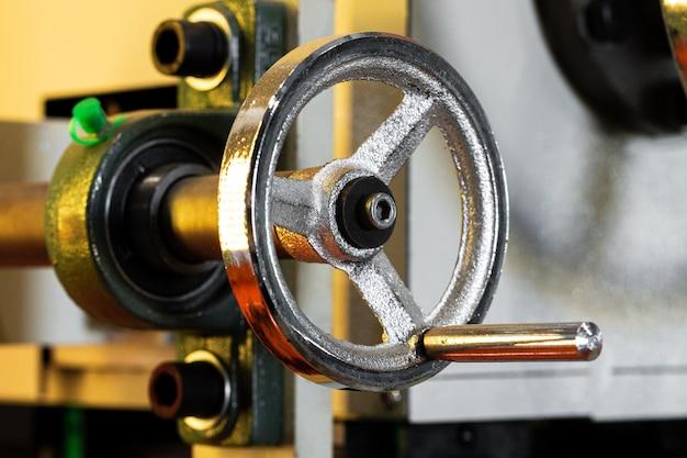 Metal valve on equipment in industrial plant
