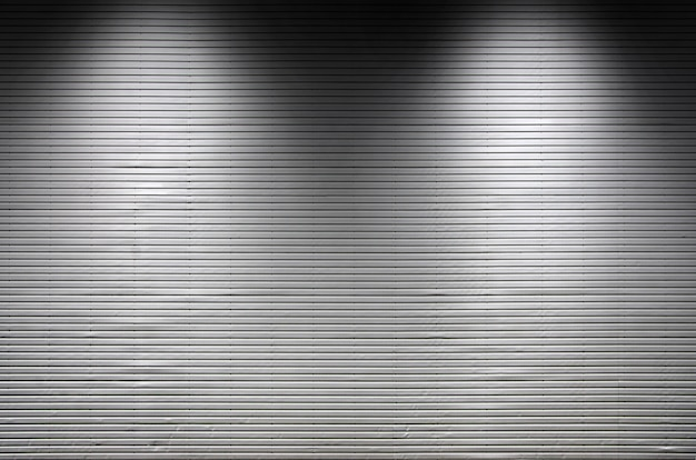 Metal wall with invisible light sources that illuminate the middle for product placement