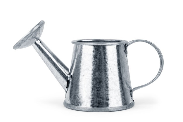 Metal watering can on a white background