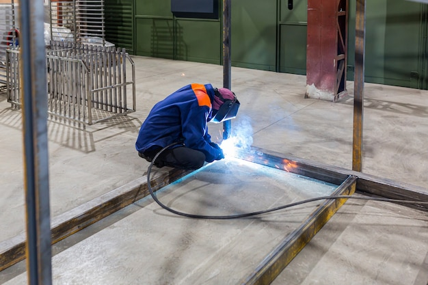 Metal welding steel works using electric arc welding machine to weld steel at factory  manufacturing and construction maintenance service by manual skill labor concept