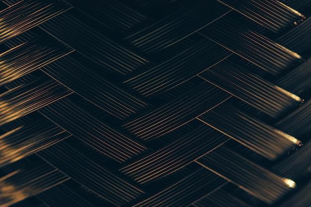 Металлический плетеный фон. стальная текстура. шаблон.