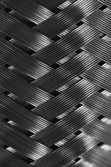 Металлическая проволочная оплетка в макросе. детальный стальной конец текстуры вверх. идеальный металлический фон с копией пространства. блестящий шаблон.