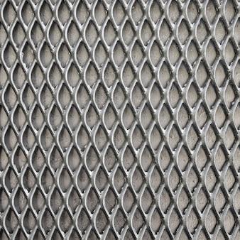 灰色のトーンの金属の背景のフェンス