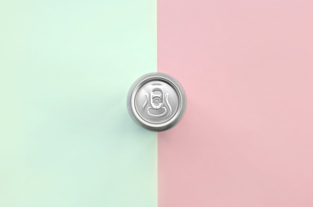 Metallic beer can on texture of fashion pastel turquoise and pink colors
