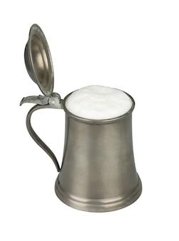 Metallic beer mug with beer isolated on white