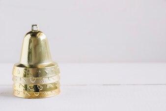 Metallic bells on white table