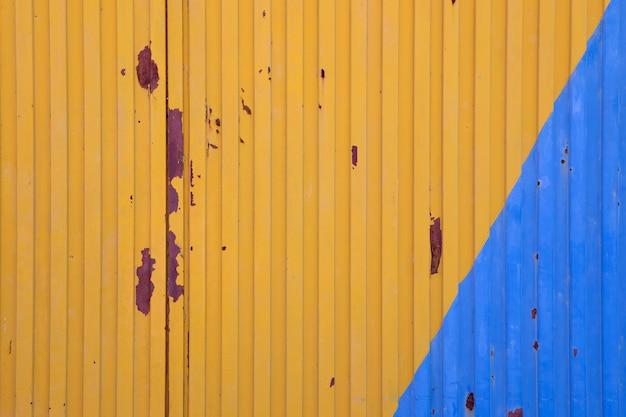 Metallic door painted in blue and yellow