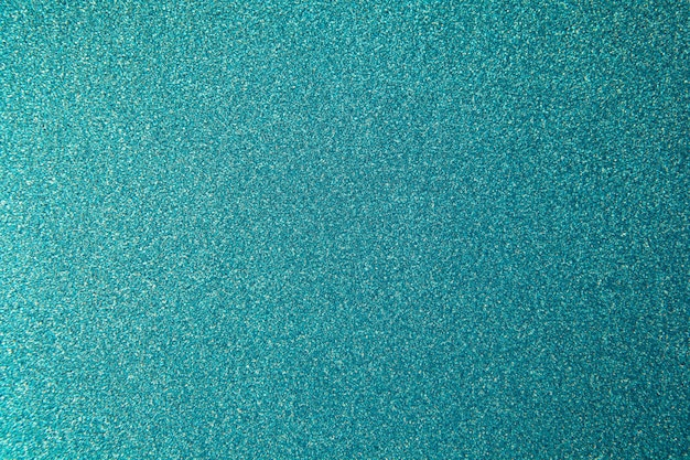 Metallic glitter green-blue background, texture with copy space.